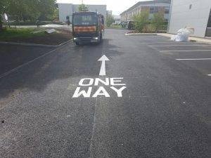 White arrow road markings