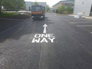 one way arrow road marking